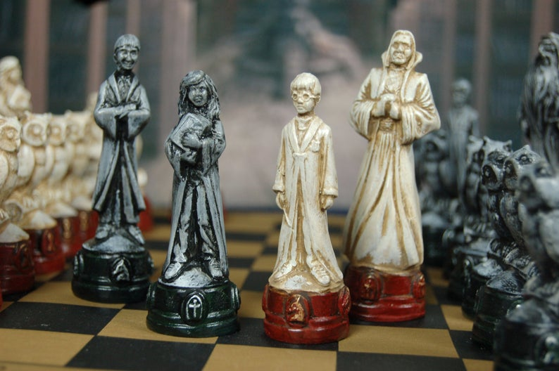 Gifts for Harry Potter fans, including chess pieces, an invisibility cloak that works, wands of 21 characters & ideas for the ultimate Harry Potter trip.